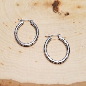 Silver Tone Metal Bamboo Design Oval Hoop Earrings